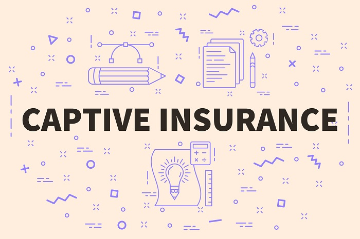 "the words ""captive insurance"" in large font with small designs of papers, calculator, pencil, ruler, and line designs around it."
