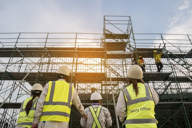 Image of Safety Officer and workers inspecting scaffolds.