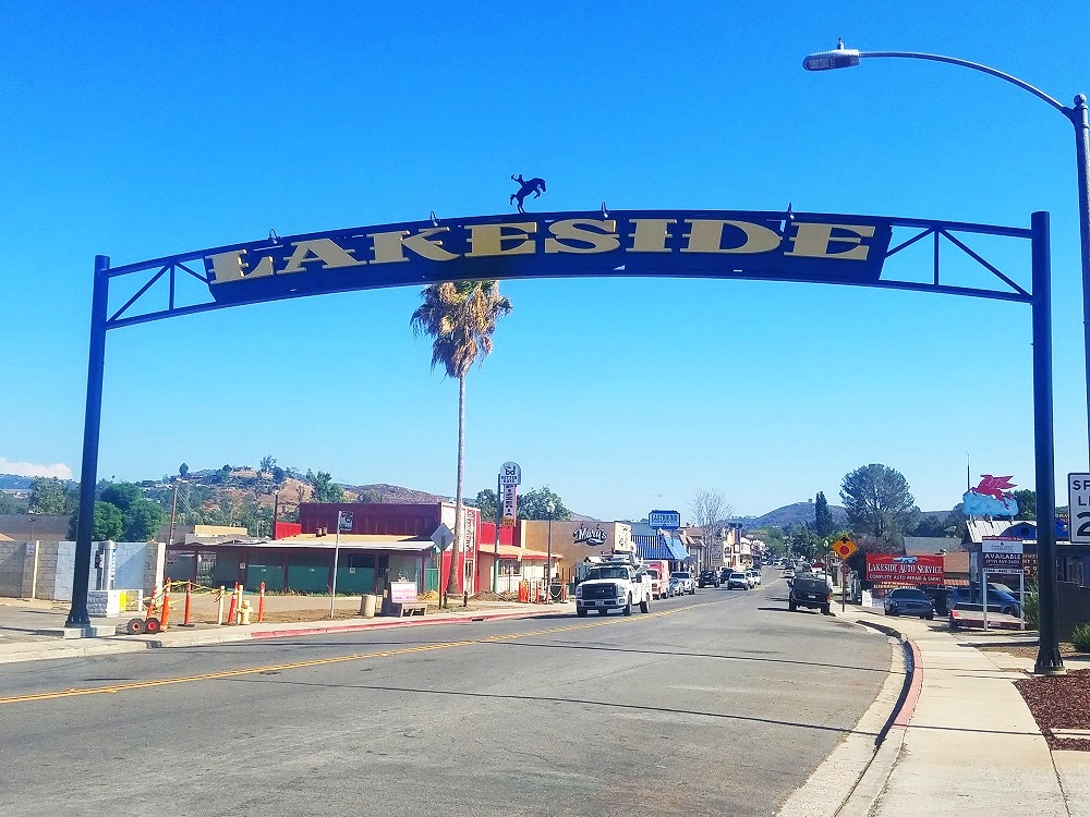 "Image of the 30-foot high ""Lakeside"" sign spanning over the north end of Maine Avenue in Lakeside, CA."