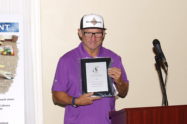 Image of John Gentillon, of The Land Stewards, holding plaque of the UCP Gold Classic.