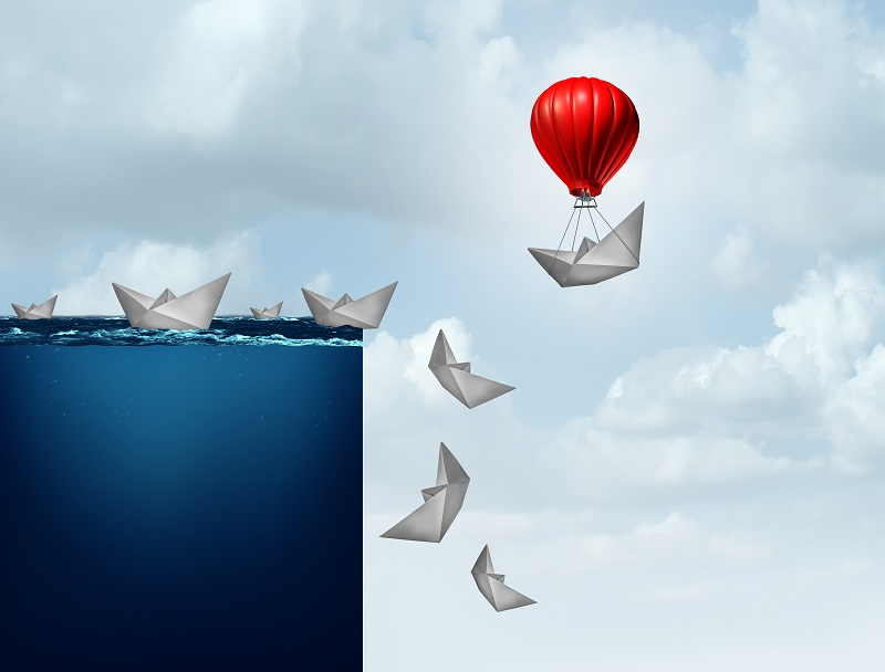 Digital illustration image of paper boats falling of edge but one it tired to a balloon and floats as the others fall.
