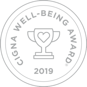 Image of 2019 Cigna Well-Being Award® logo seal. Has illustration of a trophy with a heart on it.
