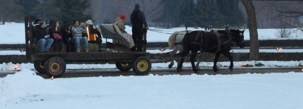 Horse drawn carriage rides in Cooperstown for Christmas on a Wellnesste Lodge weekend vacation adventure.