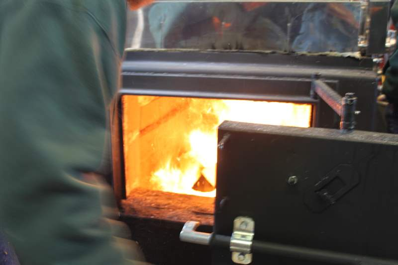 Boiling map sap into real maple syrup in taberg ny- central new york