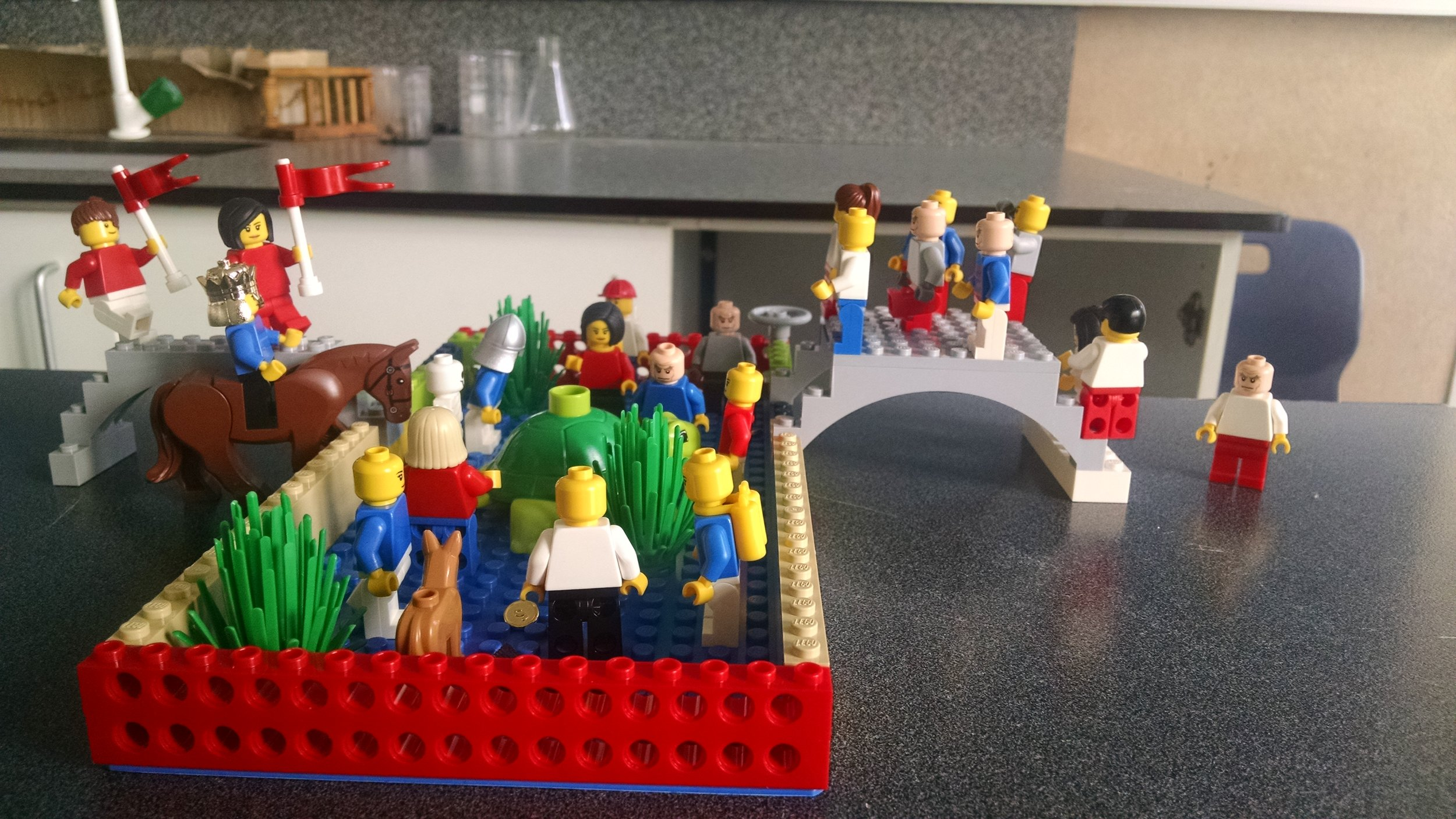 One of our student groups' designs: 'ordinary leadership' to them looks like a supportive community encircled by a low wall to keep people safe, and bridges to bring others into the community.