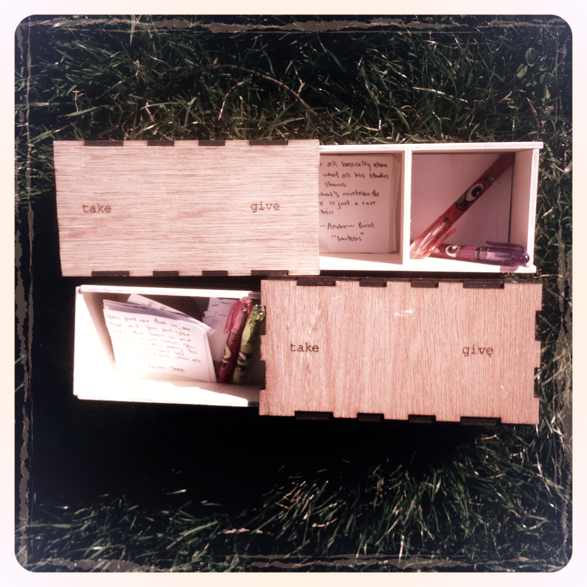 Finalized boxes with quotes, paper, and pens.