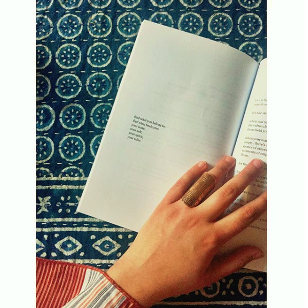 image of the inside of the book with a hand holding it open