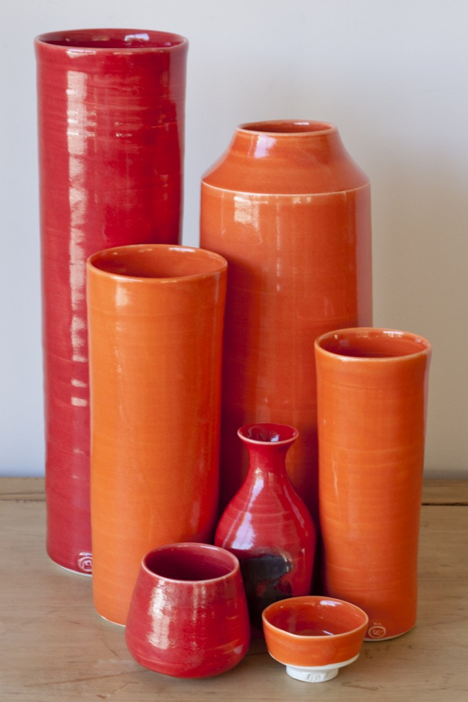 Red and orange vases and cups