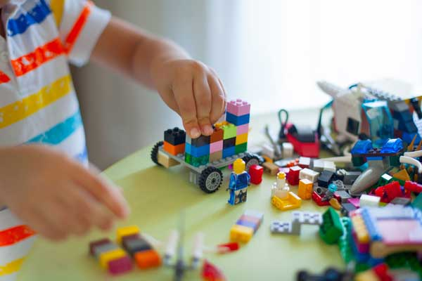 Young Boy Playing With Legos