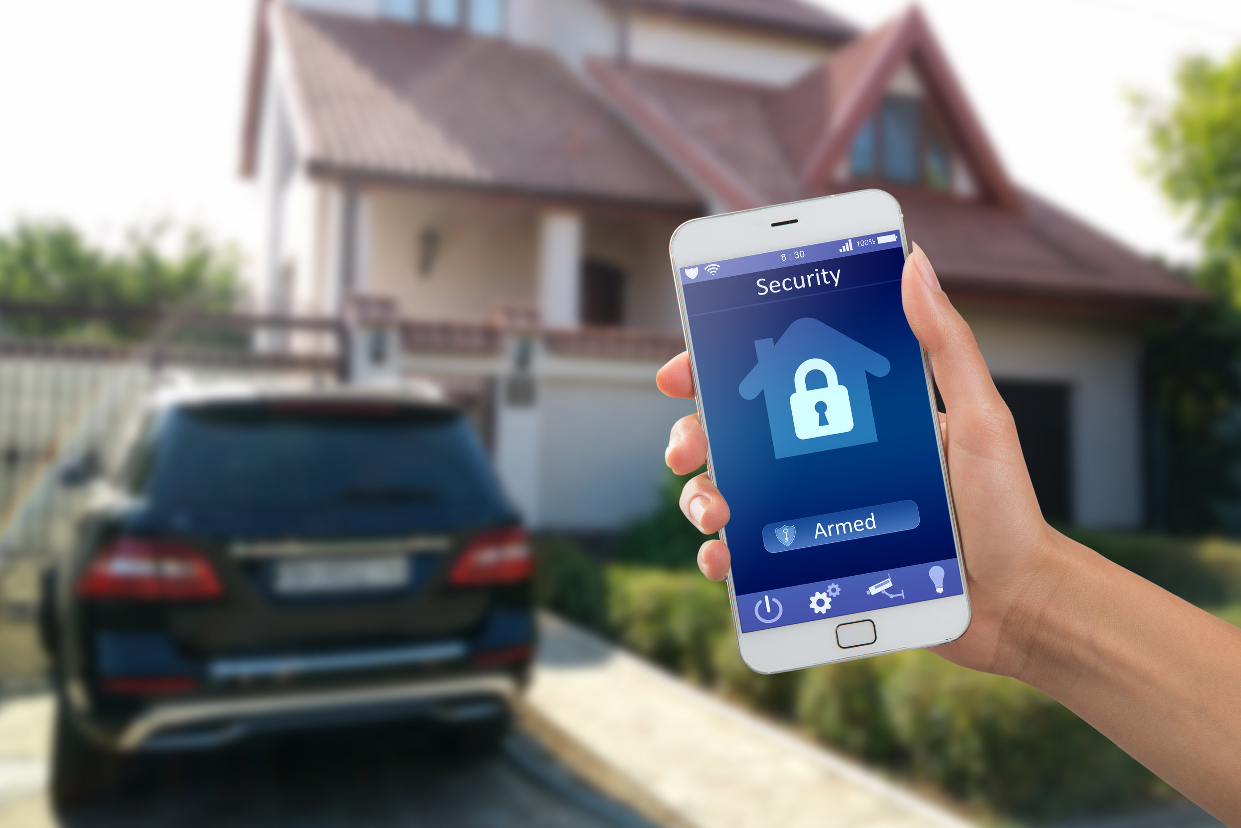 stock-photo-smartphone-with-home-security-app-in-a-hand-on-the-building-background-567476830.jpg