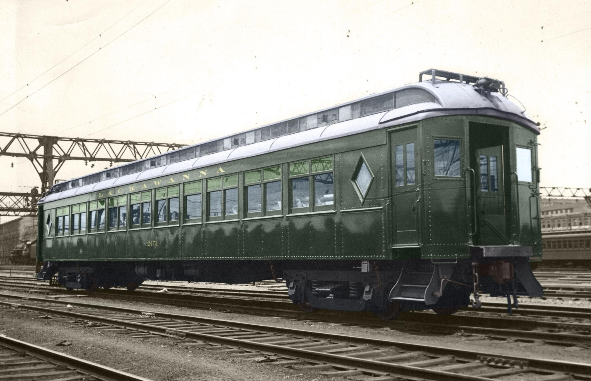 DL&W Club Car 3454 0 #2451 at Hoboken c-1930 - 1931 MU w-stained glass windows EDIT.jpg
