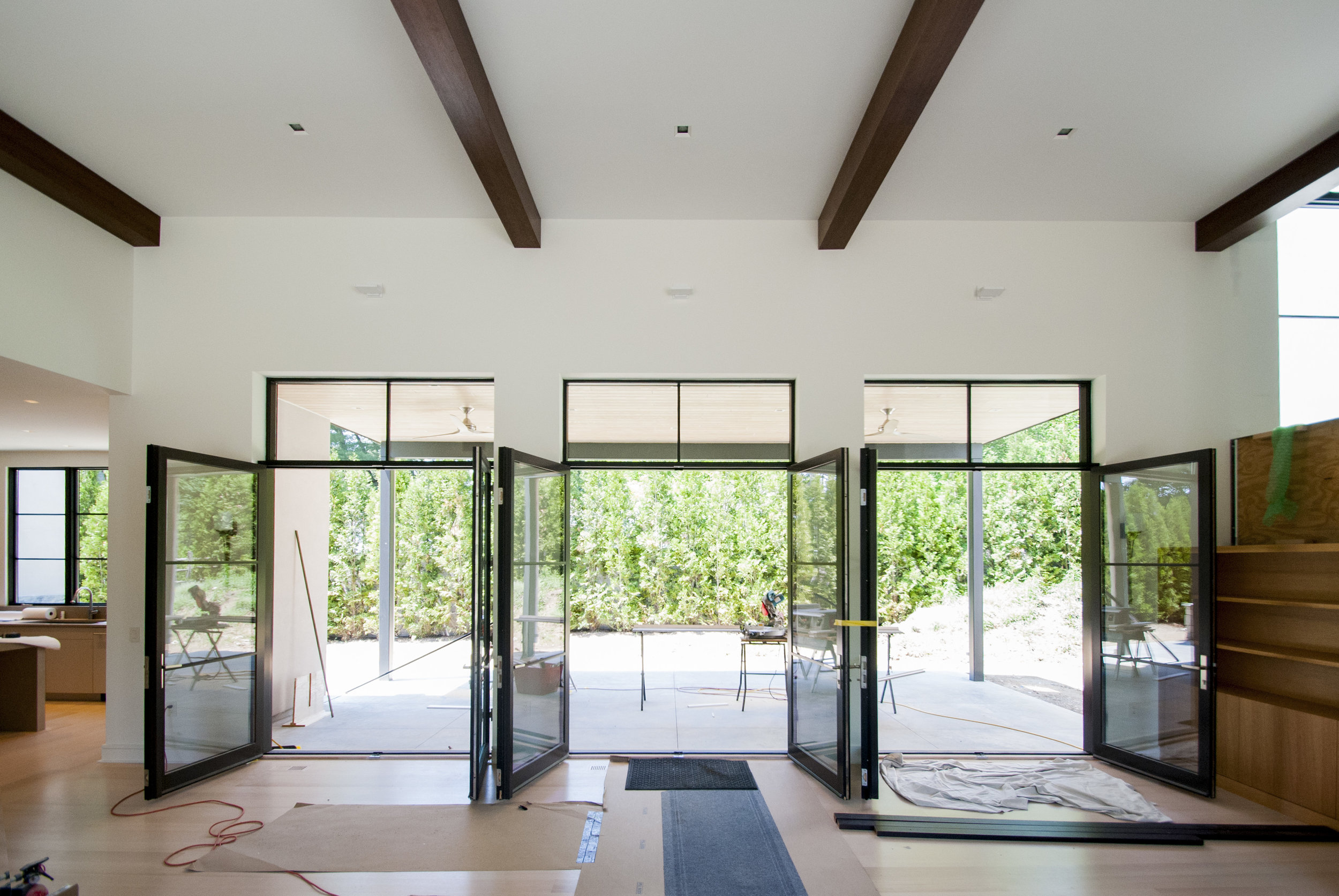 The space makes use of 3 large doors that lead out onto the rear patio.