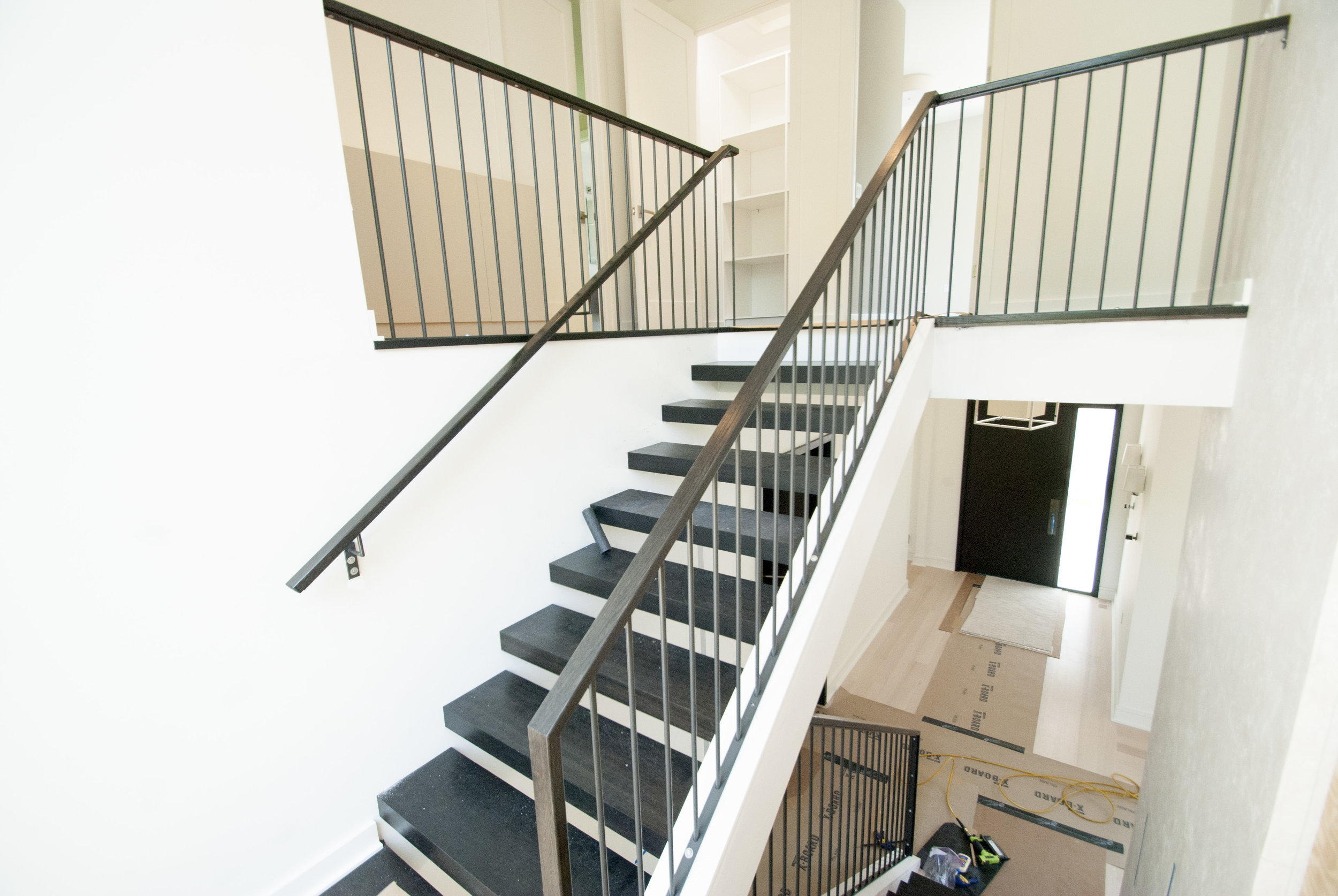 Modern stairs connect the upper and lower levels