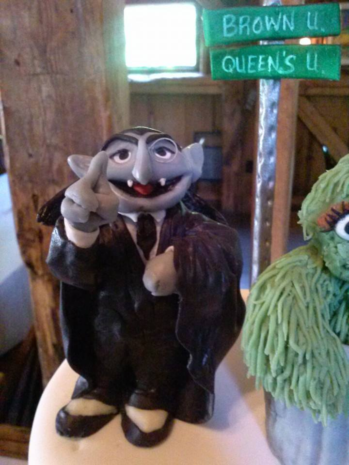 The Count Modeling Chocolate Cake Topper