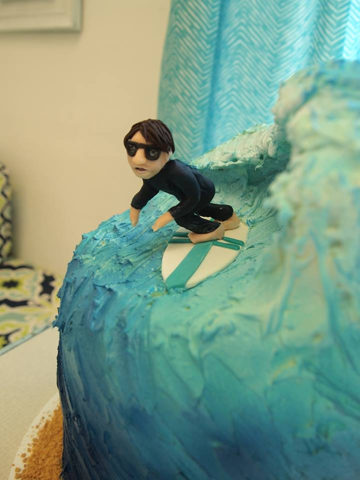 Surfer Modeling Chocolate Sculpture