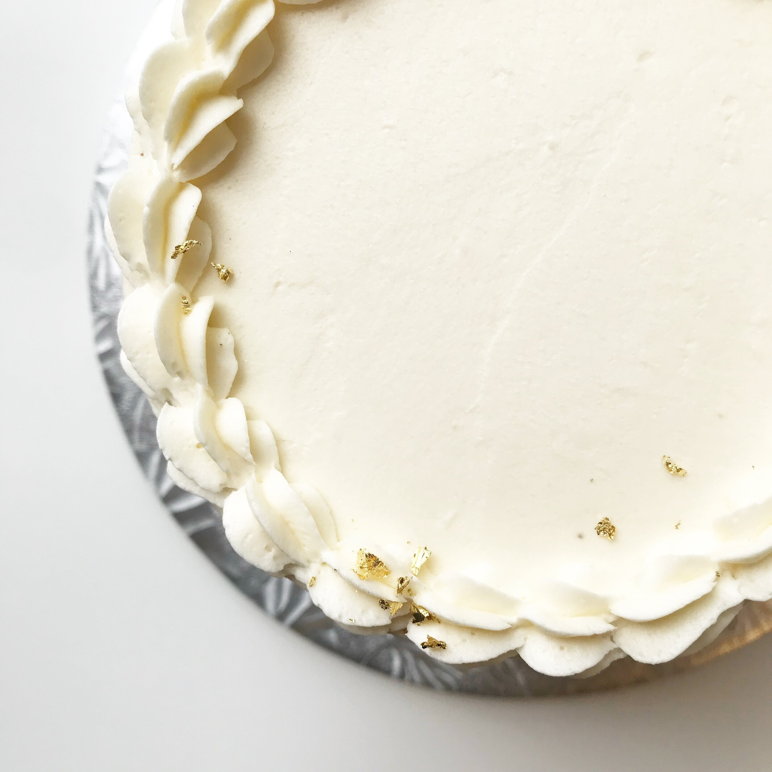 VANILLA CELEBRATION CAKE (GF/P) (K)* or (DF) Option Available   Available in classic or 'naked' frosting styles. *Keto option: Approx. 4g NC per size standard slice