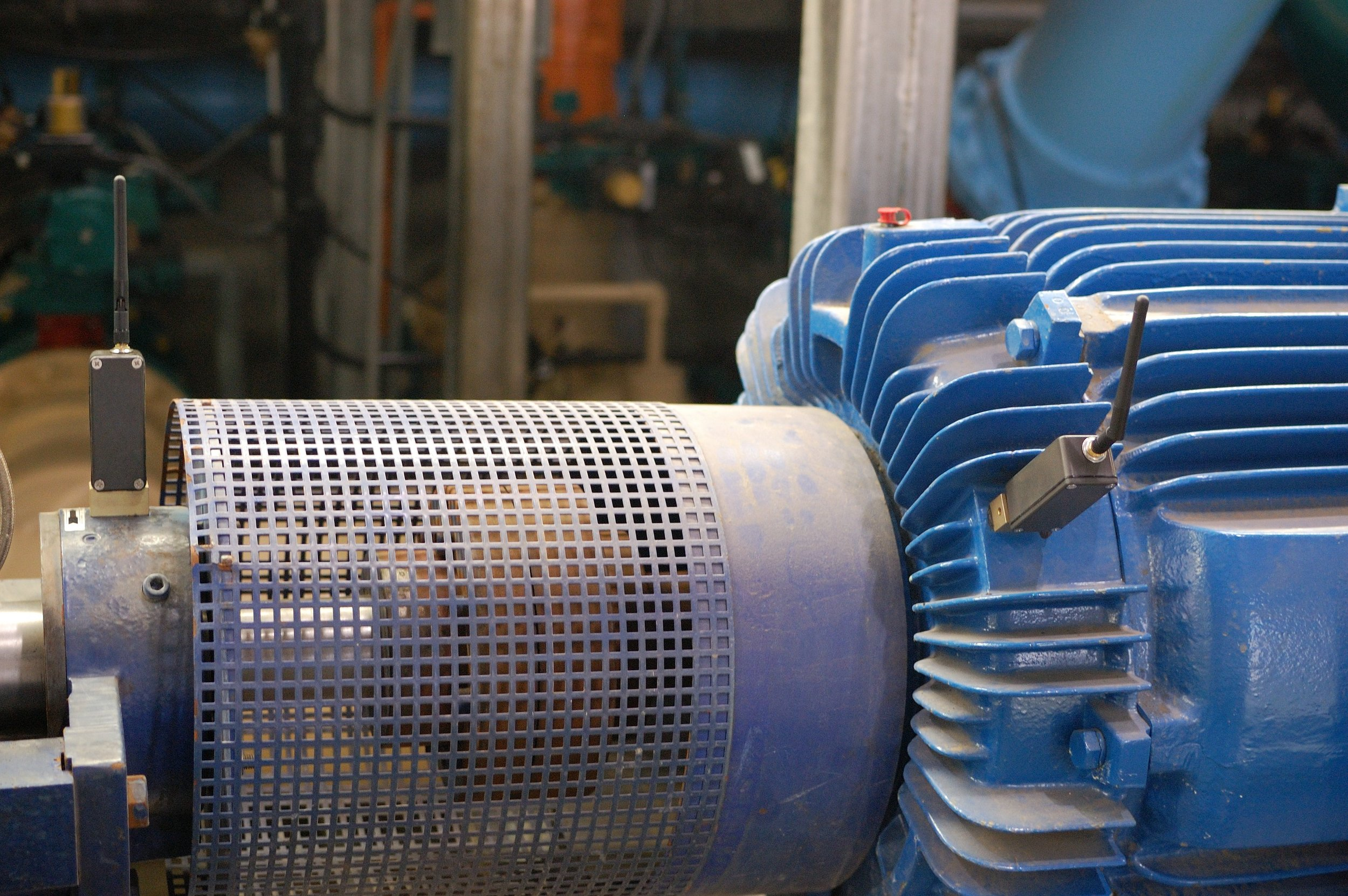 SmartHAWK wireless vibration and temperature sensors installed on a motor at a water treatment facility.