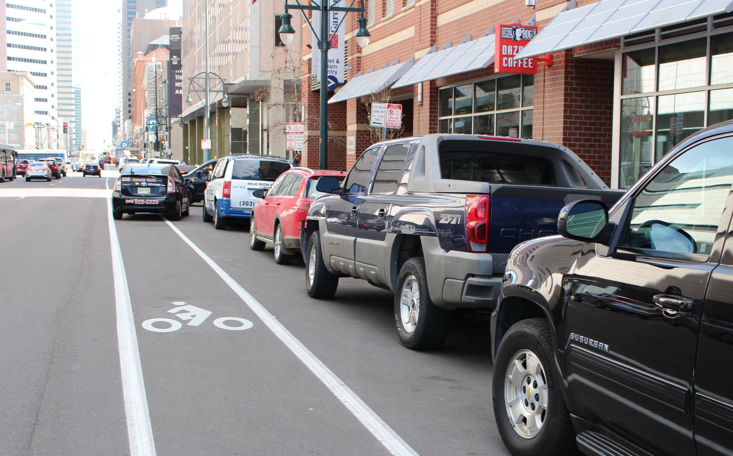 Downtown Denver – Taxi Cab Blocking Bike Lane