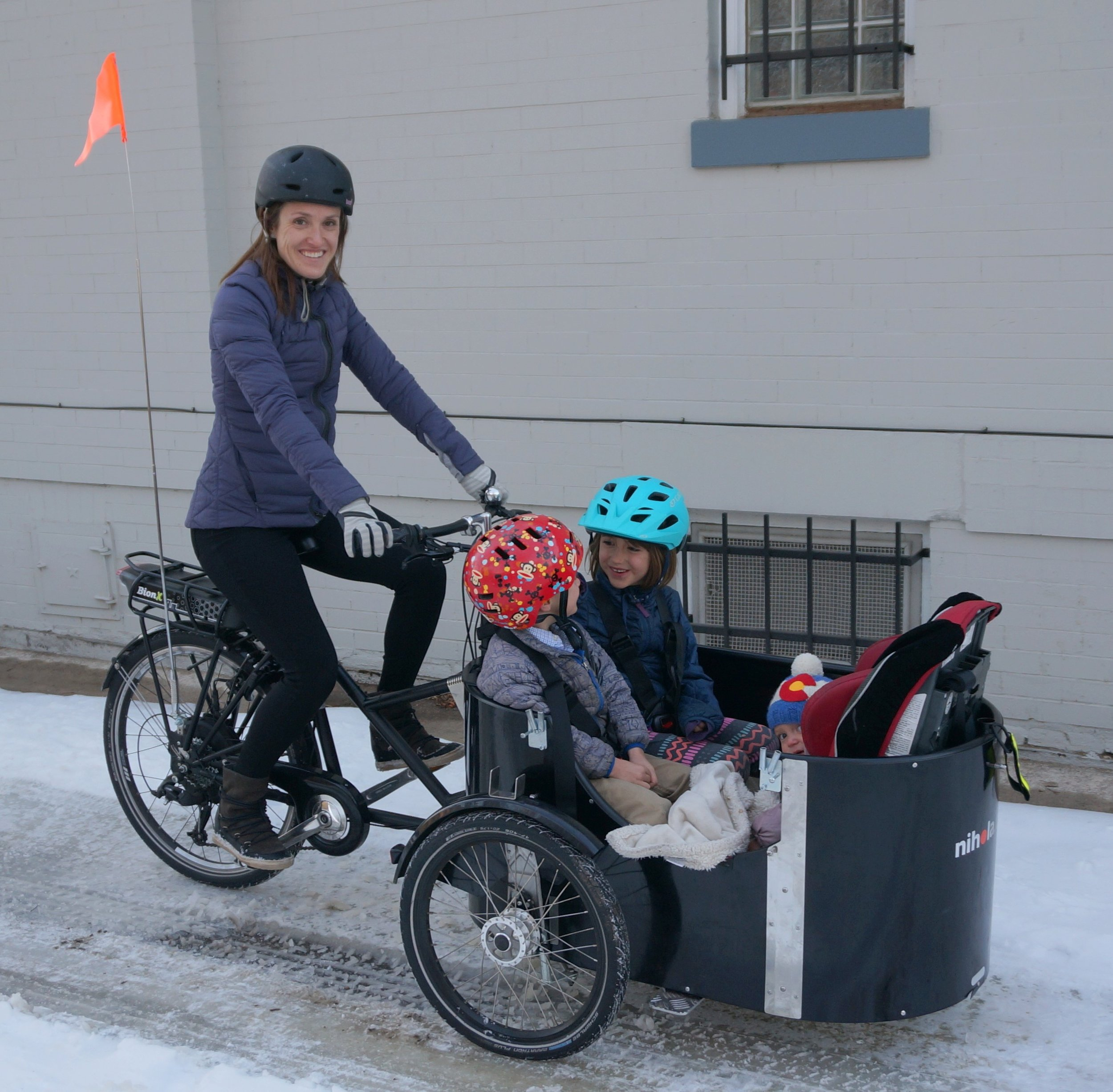 Melissa with kids in cargo bike (1).jpg