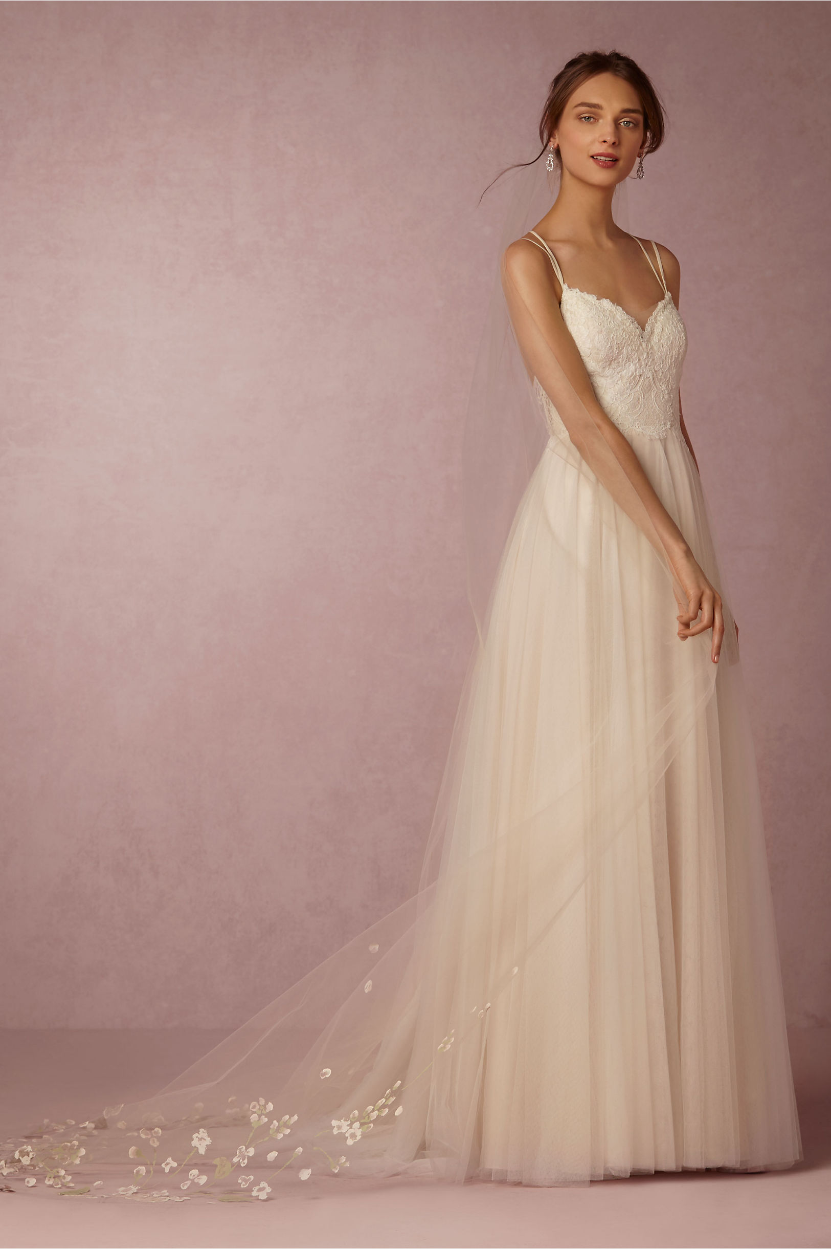 Shopping Tip: BHLDN is the place to shop for dramatic and detailed veils. The price tag is a little steep at $495, but the design is gorgeous.