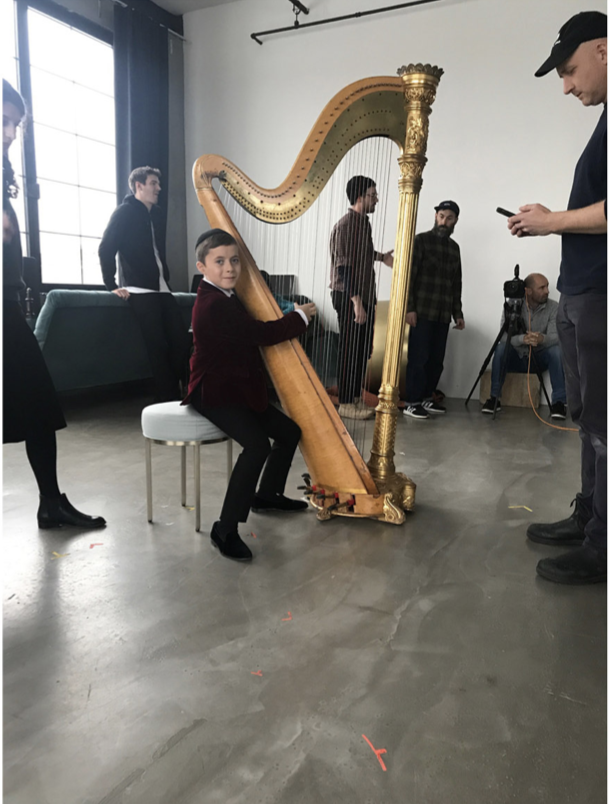 Sweet Silbert boy serenading on-stage with subtle sounds of silence. (Prop master was watching over the harp like a hawk 🦉- no Hawk emojis avail)