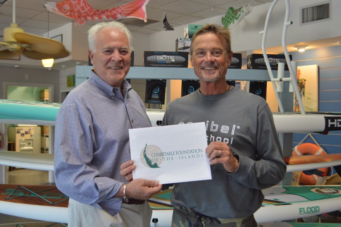 Chip Roach, Vice Chair of the CFI Board of Directors, awards Dr. Bruce Neill, Executive Director of Sanibel Sea School, with a capacity building grant.