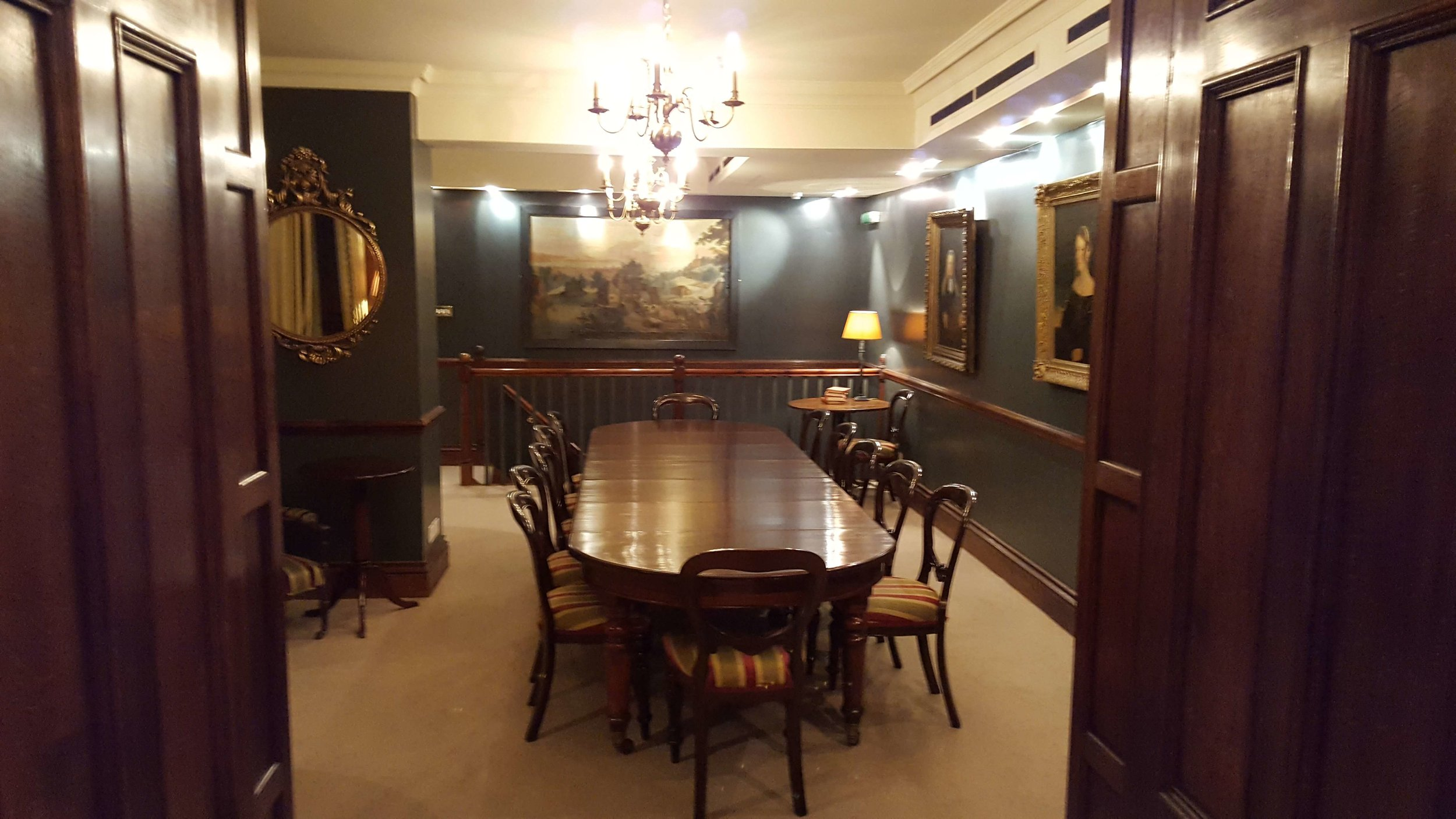 This the round table where we'll meet each morning, inspired by the formidable women portrayed on the walls.