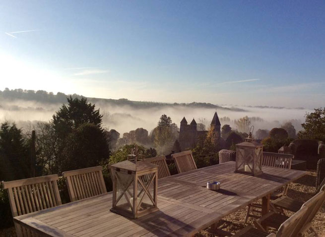 Misty morning view at outside table in French countryside retreat
