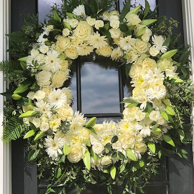 A wreath to warm your heart and home on any occasion. 🌿🌿🌿. #wreath #thinkingofyou #frontdoor #kindgesture #ruscus #fern #roses #lillies #sprayroses #thistle #gerberdaisy #mums #boxwood