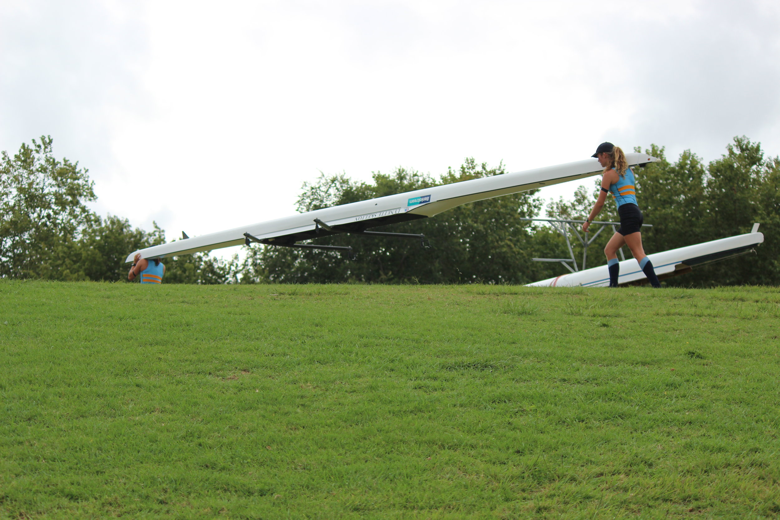 Girls u15 double scull out of boat.jpg