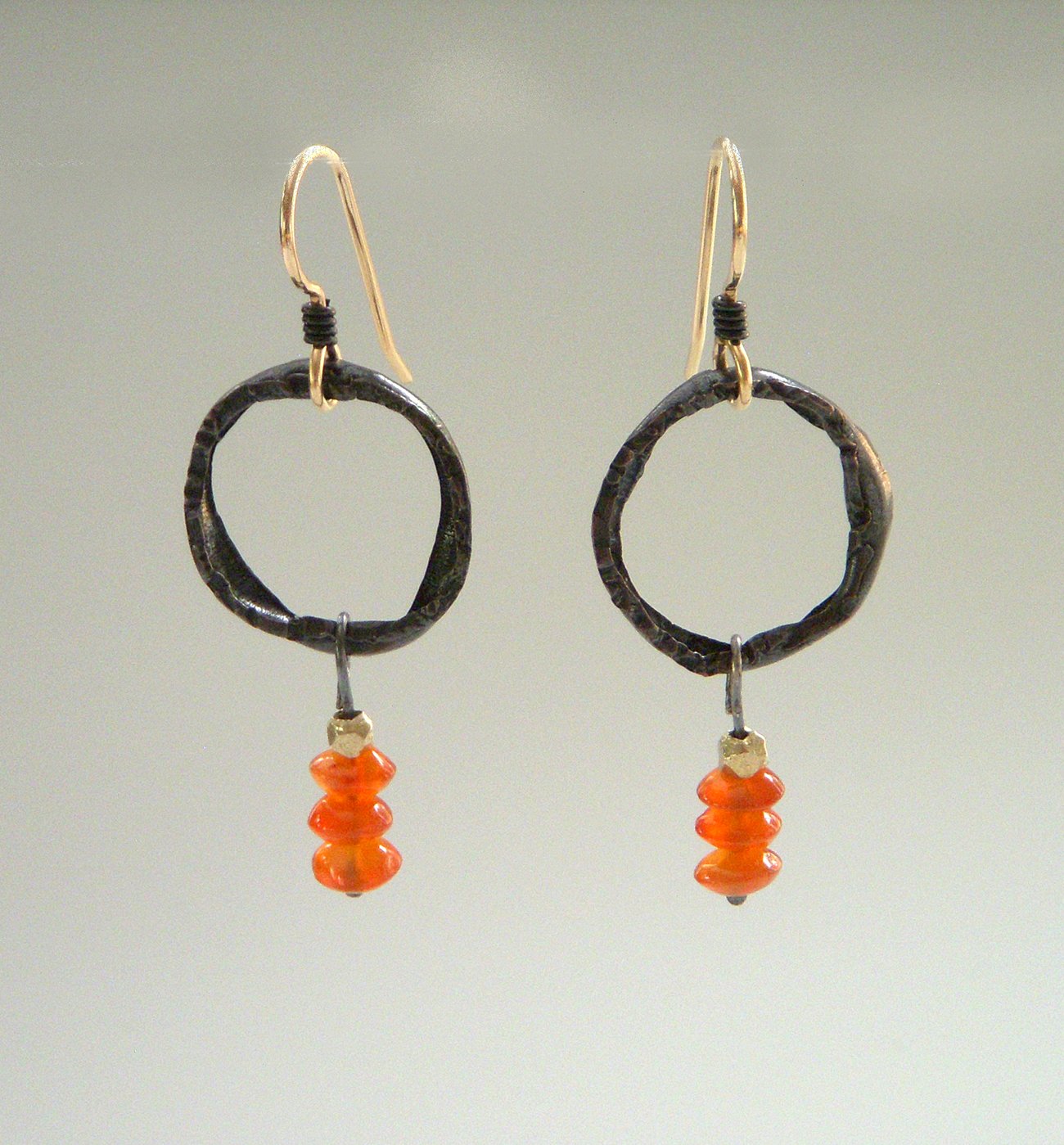 Large crushed copper circles with carnelian bead drops.