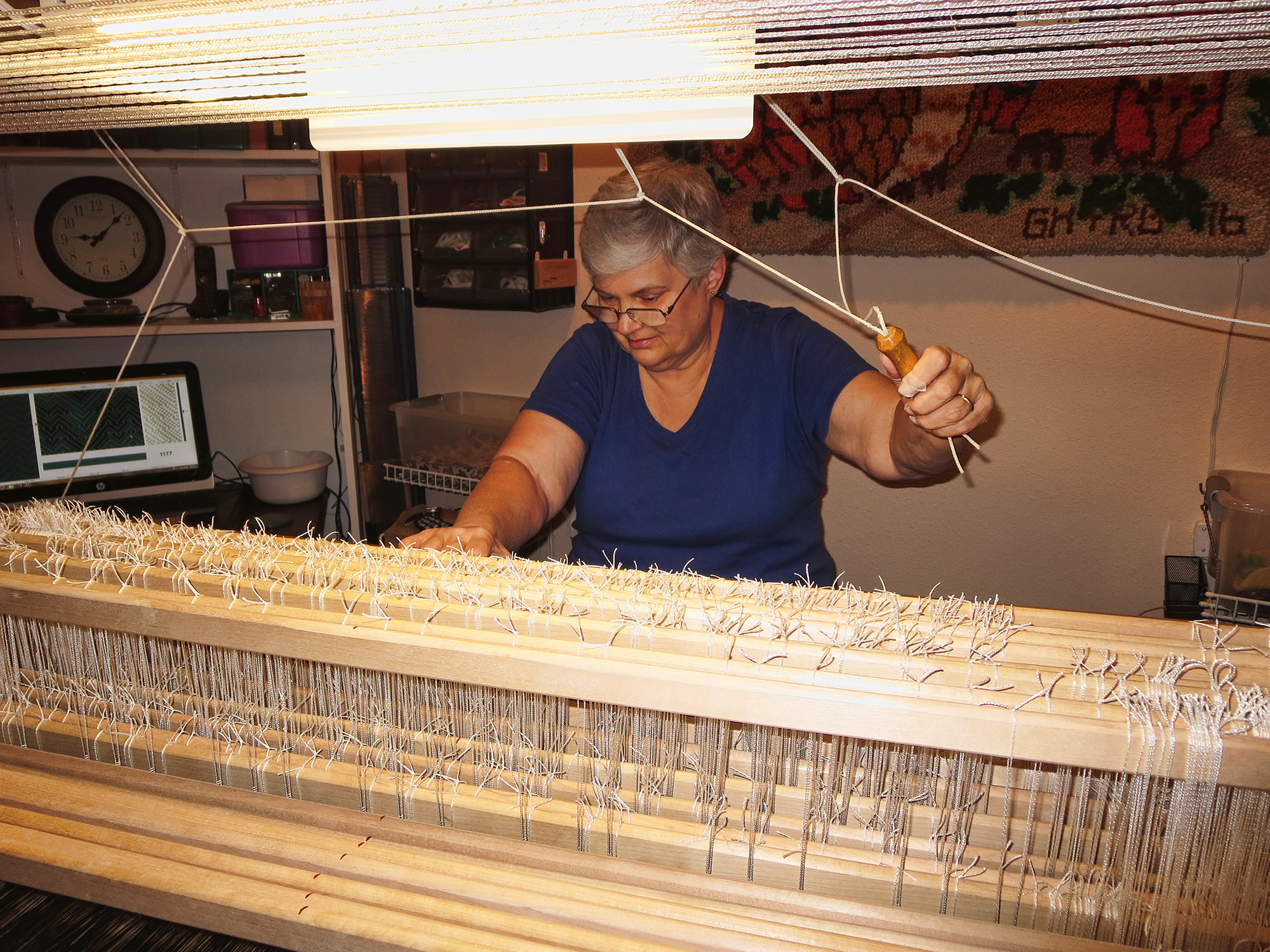 -  Weaving on the 24-shaft loom