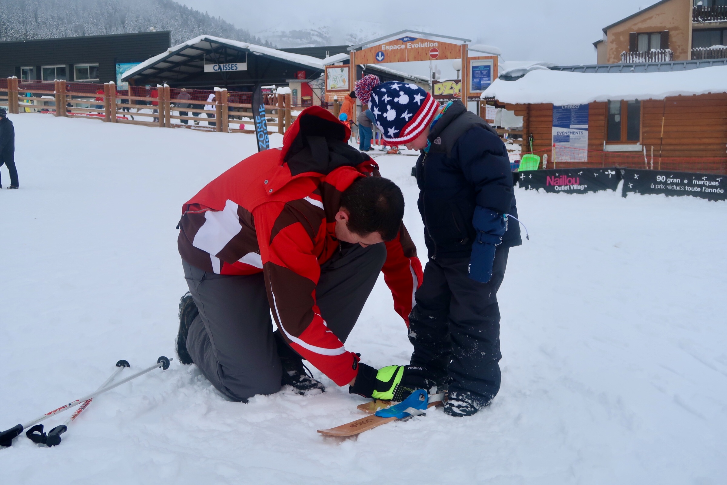 Strapping on his wooden skis for the first time
