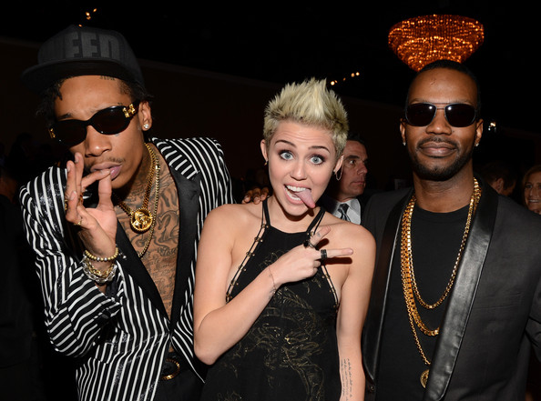 Wiz Khalifa, Miley Cyrus, and Juicy J;  Rolling Out  magazine