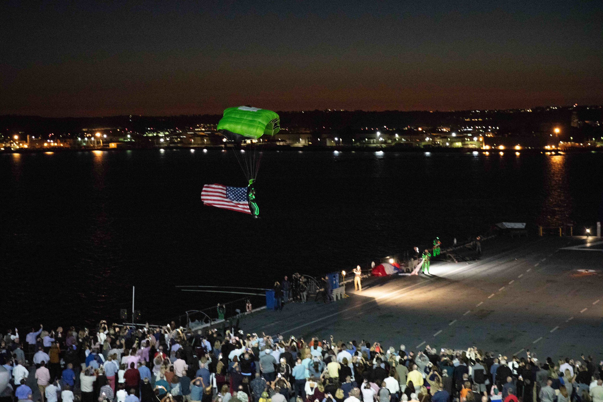Skydivers entertained the attendees by parachuting onto the aircraft carrier Midway at the meet and greet the first night of the 75th annual SMACNA convention.