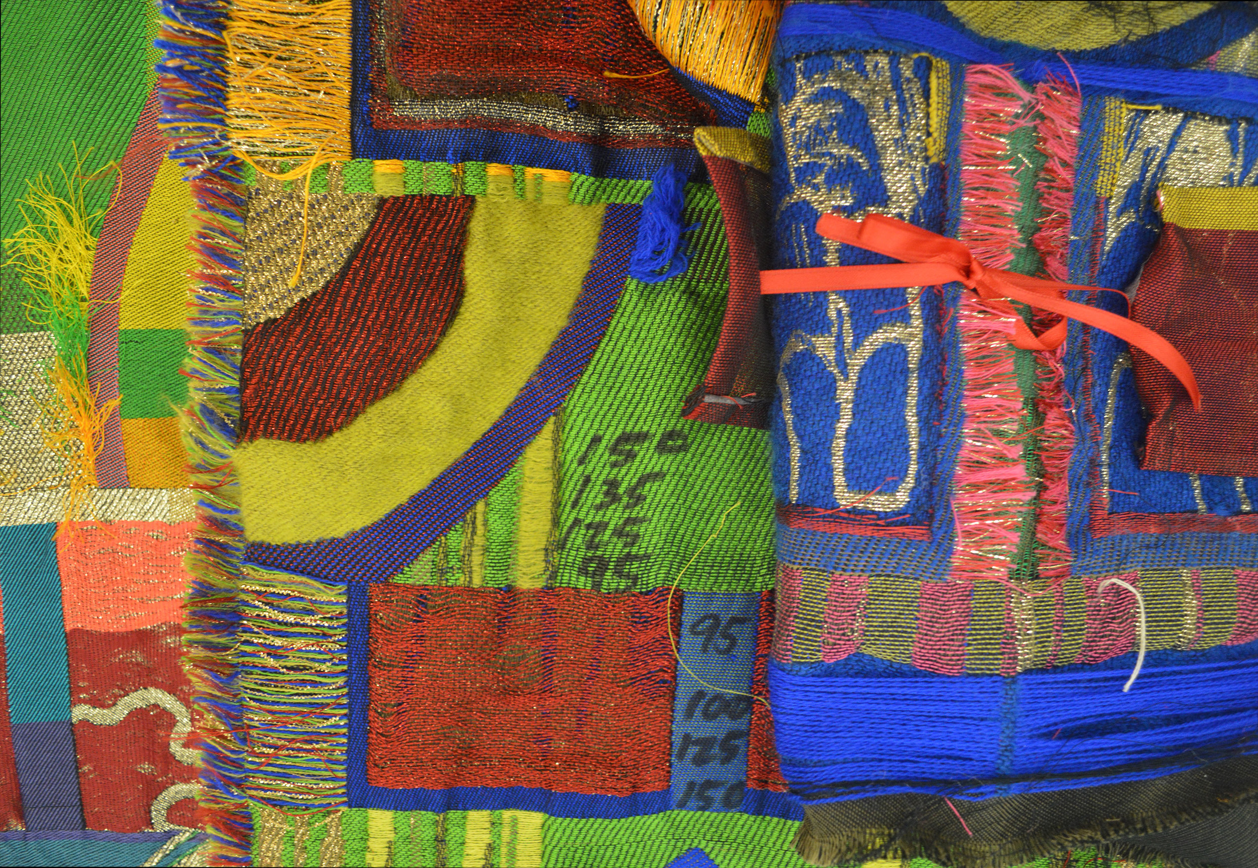 Several woven trials experimenting with various weft sequencing in material, size, and color