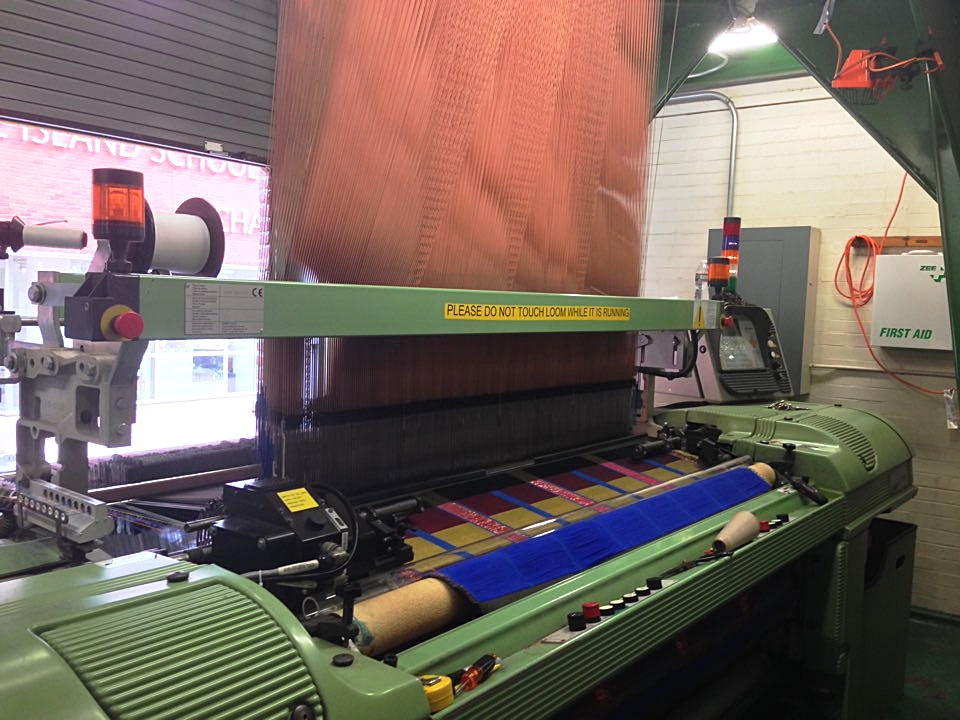 Final design being woven on the industrial Jacquard loom