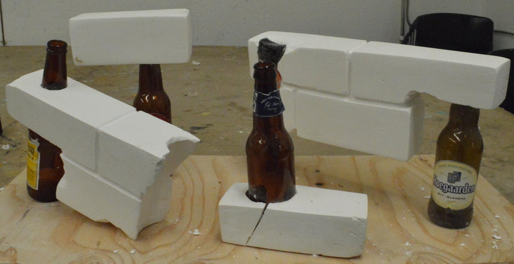 """""""Bricks"""" 2014  Plaster and glass bottles"""