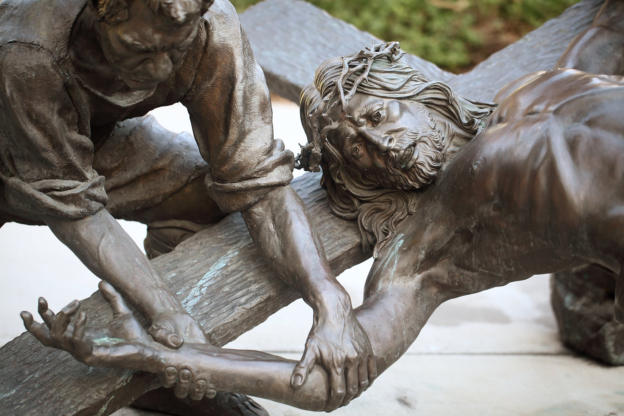 Slatoff_Jesus Being Nailed to the Cross_Bronze_atPrayerGarden_0011.jpg