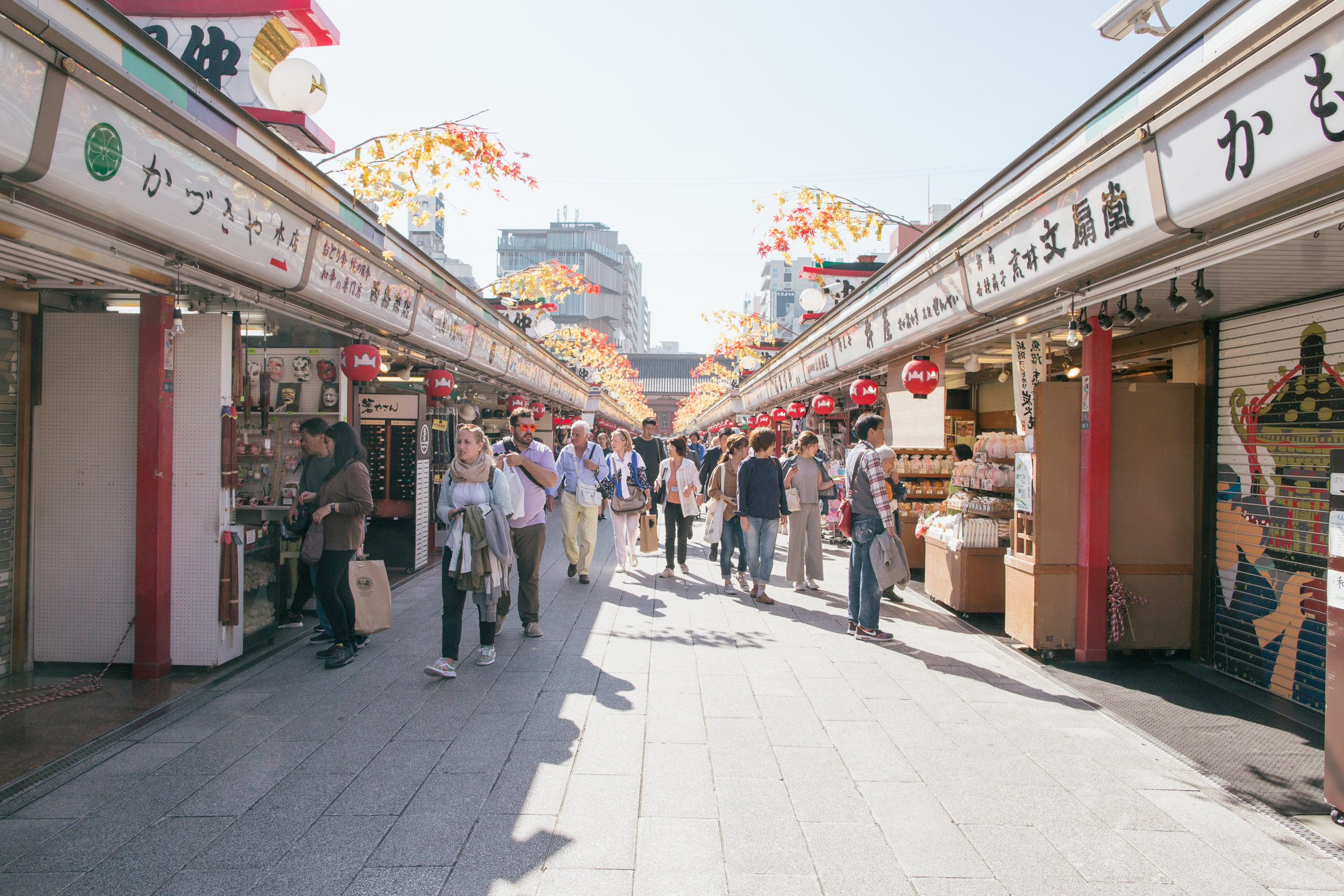 The street leading into the Senso-ji in Asakusa. Pictured here is Nakamise-dori which is lined with shops selling snacks and souvenirs. In the distance you can see Kengo Kuma's Asakusa Culture & Tourism Center.