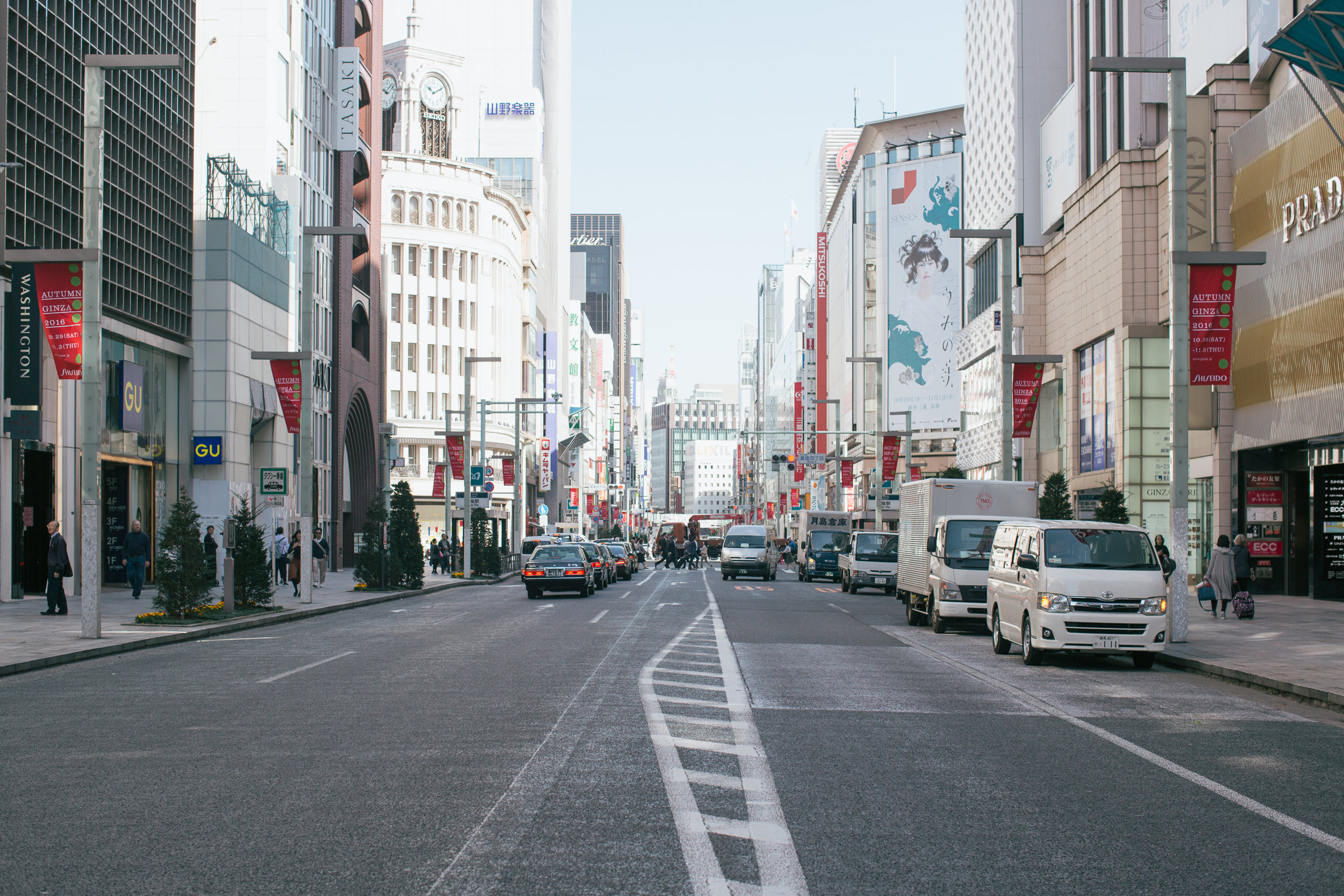Streets of Ginza. In the upper left of the photo you can see the iconic Ginza clock tower on top of Wako. Prada opposite GU. Just thinking about how much one purchase at Prada could buy at GU...
