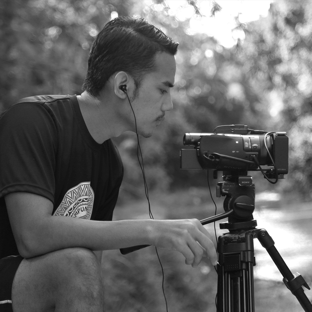 """Feisal Azizuddin, Executive Producer / Director     """"Growing up, I remember my brother and I loved to play make-believe, come up with stories and act out these adventures. This was when I realized I had a passion for storytelling.""""    In 2010, Feisal co-founded a media company called Feisk Productions. He began crafting corporate videos. In 2014 he ventured into TV and produced two reality shows which aired on local TV and VOD platforms.  In 2016, Feisal shifted to focus on film. He directed and produced over 20 short films which have been screened in genre festivals across the world.  In 2019, Feisal was selected as a Fellow by Busan Asian Film School for their International Film Business program."""
