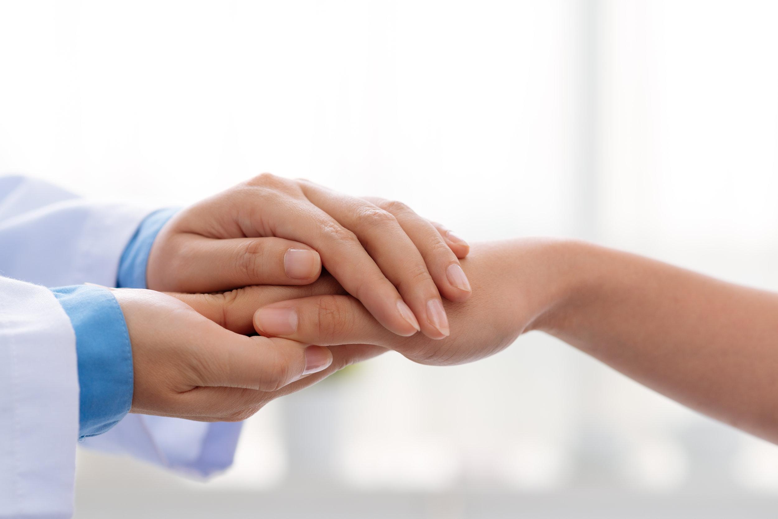 doctor hands reassuring