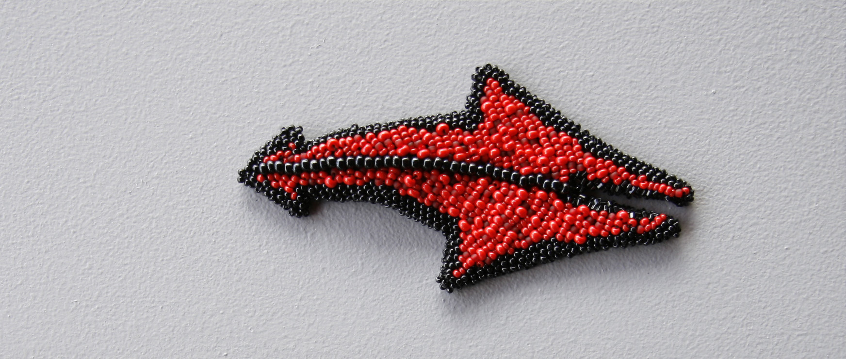Duende (2010). Felt & glass beads.