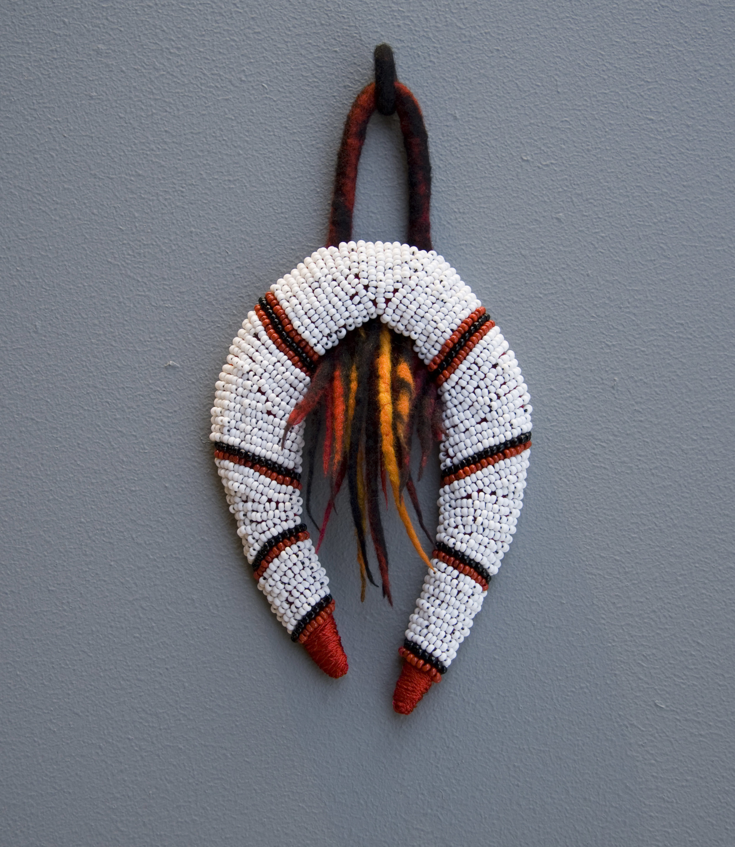 Itzikker (2010). Felt, beads & thread.