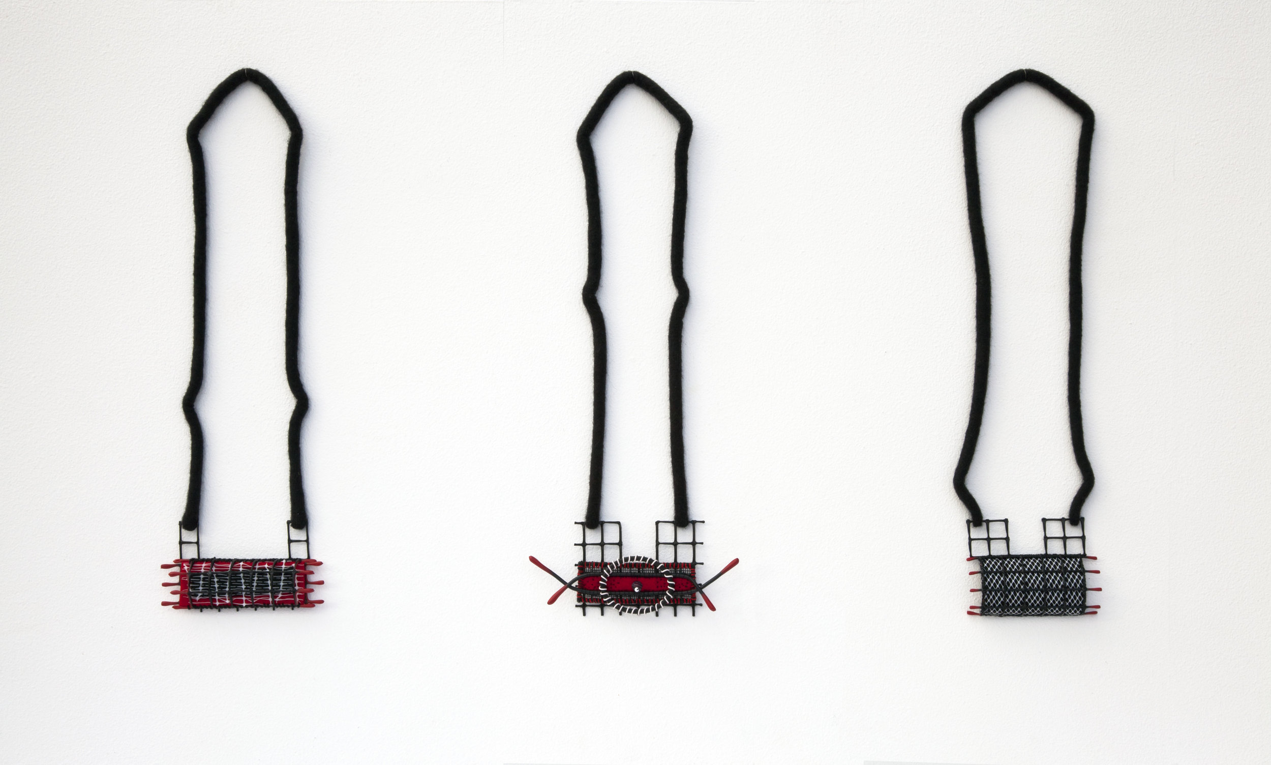 Spanish Whispers I, II & III (2011). Felted merino wool, plastics, wires & glass bead.