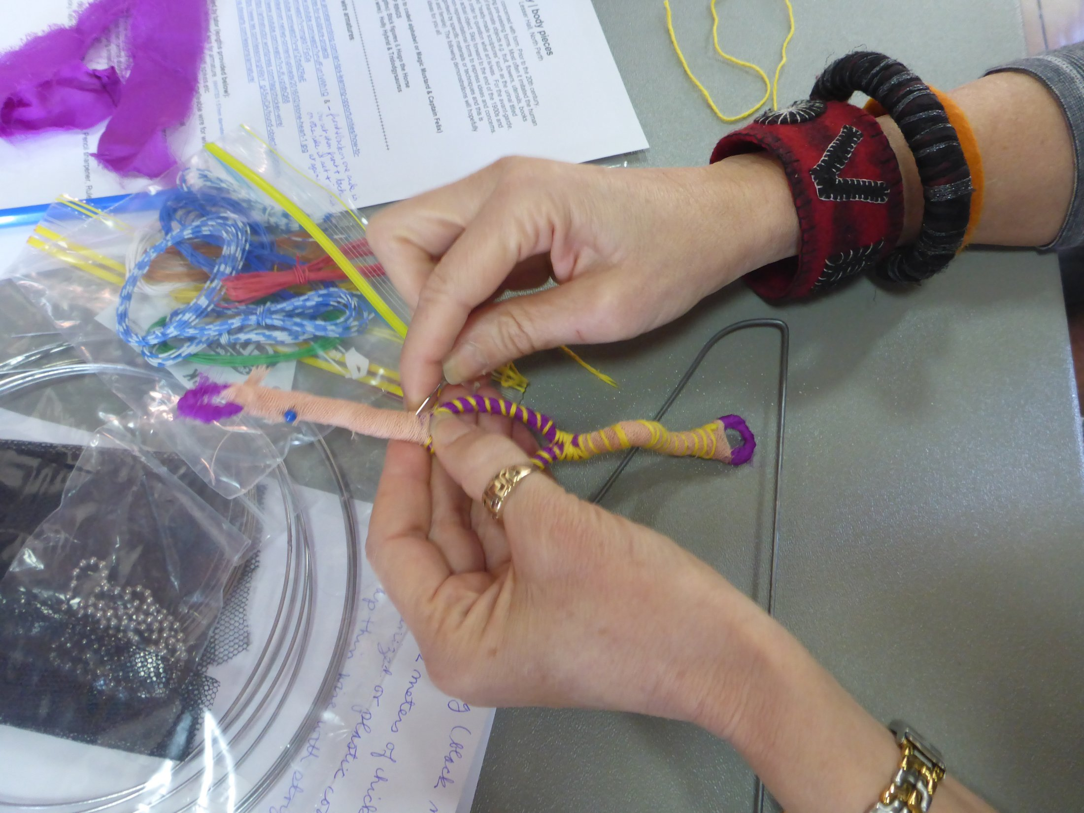 Stitching demo on wire at a textiles workshop