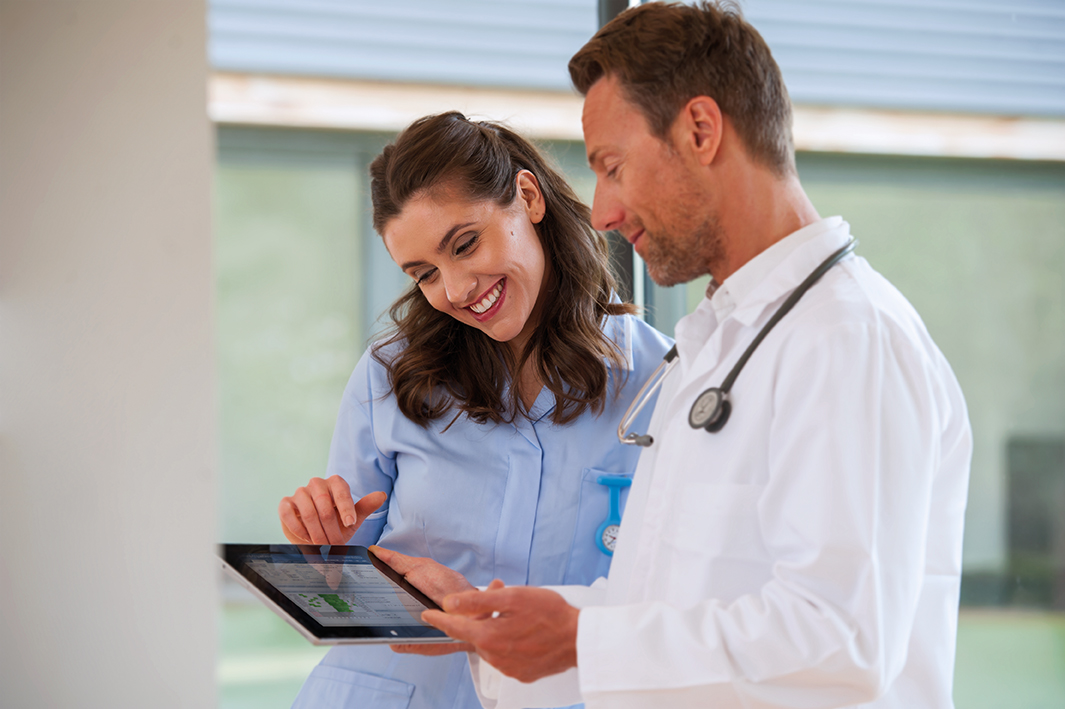 Encore Anywhere physician and clinician with screen LR.jpg