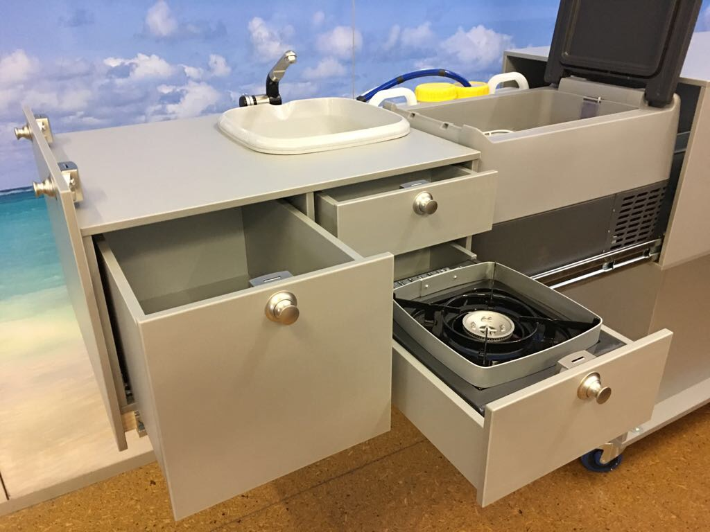 The fully contained Amarok Slide Out Kitchen contains a 35 litre Dometic Waeco Fridge, 3 draws including one designed for the cooker, plus a fully functioning sink (with optional shower) serviced by 32litres of water.
