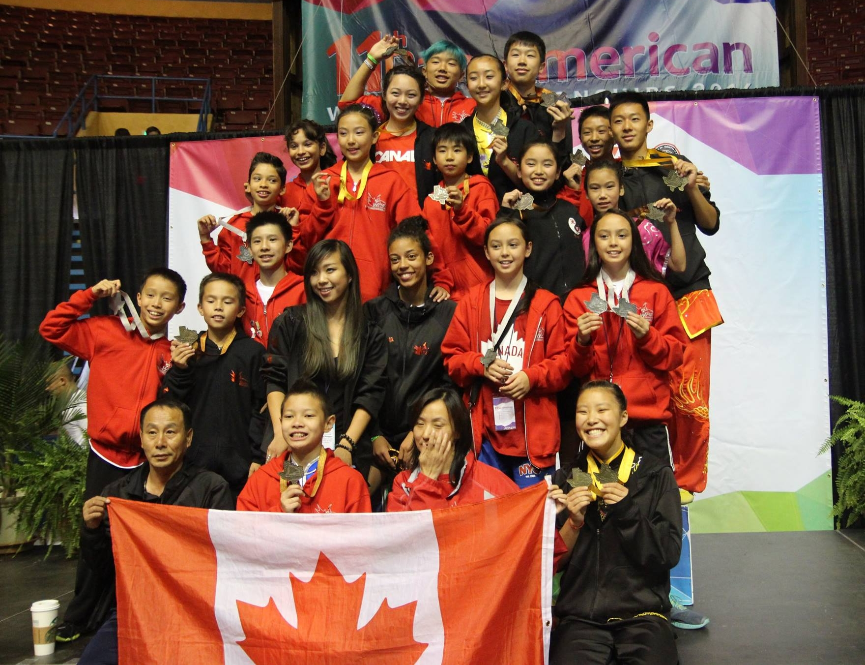 Teams Canada and China at the 6th World Junior Wushu Championships, 2016.